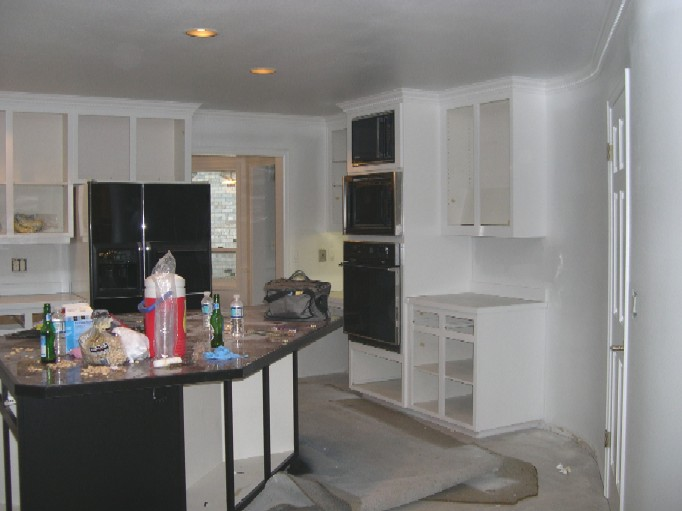 kitchen painted with black & white cabinets